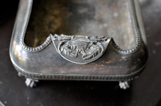 This is my other treasure from the antiques fair, a great little crab-handled cachepot.  How could I resist?