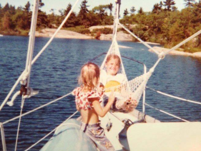 Kathy in the hammock  and our cousin Robin on the canoe, soaking up sunshine.