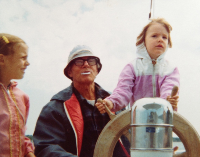 My sister Kathy, Grandpa, and me at the helm circa 1976.